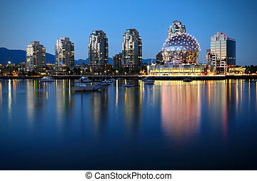 Vancouver Skyline at night with street lights.