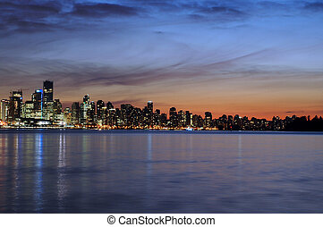 Vancouver skyline in the evening sunset across Burard Inlet