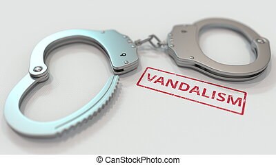 VANDALISM stamp and handcuffs. Crime and punishment related ...