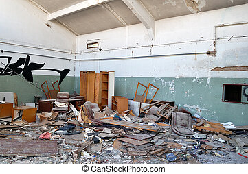 abandoned factory - Vandalized office equipment and debris ...