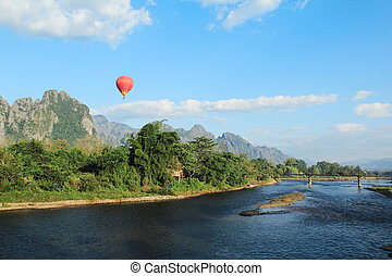 Vang Vieng is a town that is beautiful. Hall, on the river.