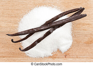 vanilla beans with sugar - photo shot of vanilla beans with...