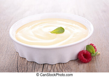 vanilla cream dessert and berries