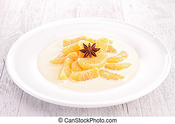 vanilla cream with slice of tangerine
