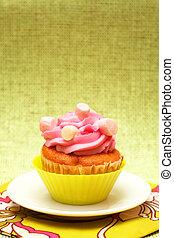 Vanilla cupcake with strawberry icing