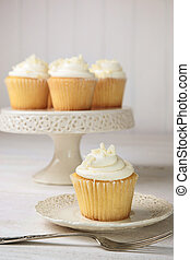 Sweet vanilla cupcakes ready to eat