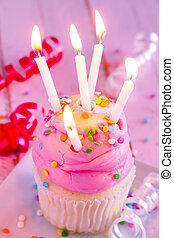 Vanilla Cupcakes with Pink Frosting and Candles - Vanilla...