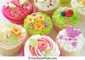 Vanilla cupcakes with various decorations - Vanilla cupcakes...
