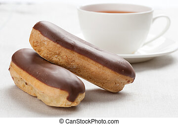 vanilla eclairs with chocolate frosting