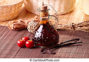 Vanilla extract with beans ans small apples