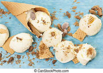 Vanilla Ice Cream, cone and cone pieces scattered