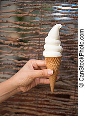 Vanilla ice cream in a cone