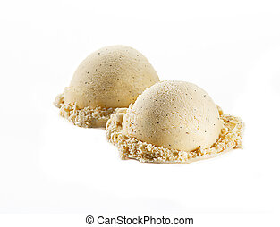 Vanilla ice cream scoops with seeds isolated on white