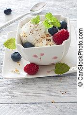 Vanilla ice cream with fresh berries