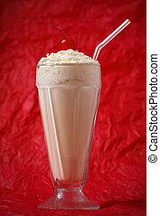 vanilla milkshake with whipped cream and cherry on the top....