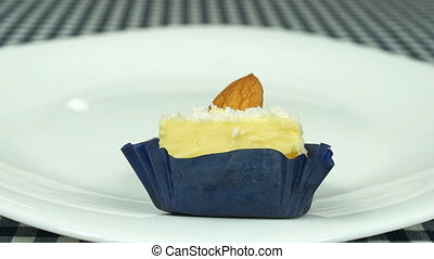 Vanilla sweets with almond and coconut powder on white dish