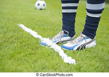 Vanishing foam spray line - Soccer player covered in marking...