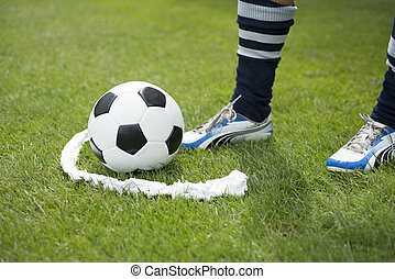 Vanishing foam spray line - Soccer player ready to play at...