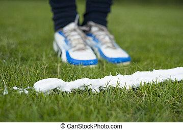 Vanishing foam spray line - Soccer player standing at foam...