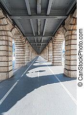 vanishing point view from under Bercy bridge in Paris