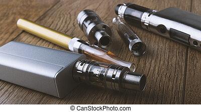 vape, megír and, vaping, berendezés, mods, atomizers, kelet, cig, kelet, cigaretta, képben látható, egy, fából való, háttér.