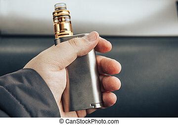 vaping, eszköz, alatt, a, bábu, kezezés., elektronikus, cigaretta