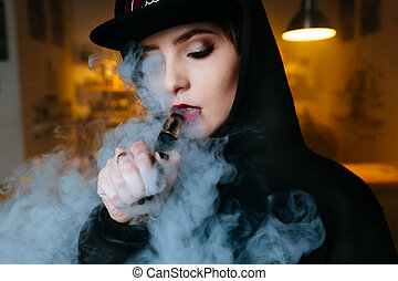 Vaping girl. Young hipster woman vape e-cig at the vapeshop...