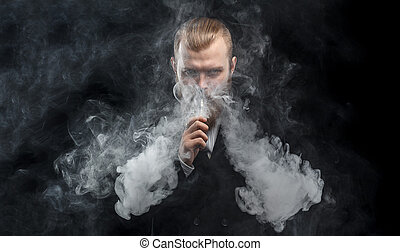 Vaping man holding a mod. A cloud of vapor. Black...