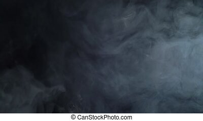 Vapor against black background - White incense vapor against...