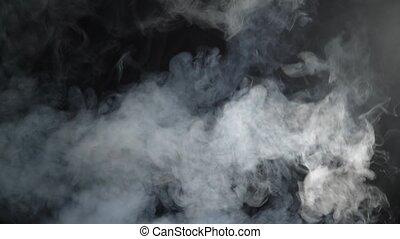 Vapor against black background - White incense vapor against...