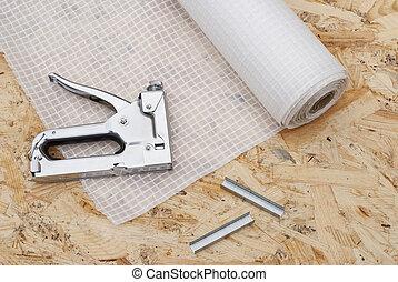 vapor barrier and mounting a stapler - roll a vapor barrier...
