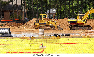 Vapor Barrier at Construction Site - Heavy equipment at...