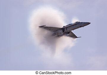 Vapor Burst - A Prandtl-Glauert condensation cloud caused by...