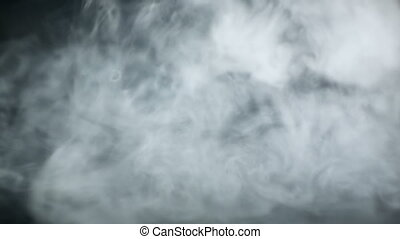 vapor from e-cigarette on black background - fast steam from...