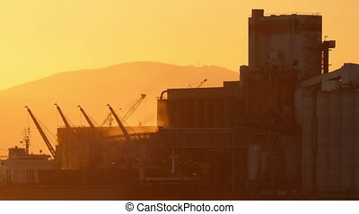 Vapor Rises From Refinery At Sunset - Factory with steam...