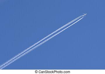 Vapour Trails - A jumbo jet flies through a perfect blue sky...