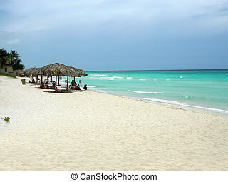 Varadero beach Cuba - Cubans relaxing in the warm weather at...