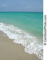 waves gently breaking on the shore of tropical varadero beach in Cuba