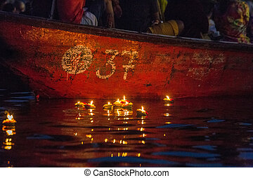 Varanasi burning candles floating in the Ganges river, India...