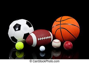 variado, deportes, pelotas, en, un, fondo negro