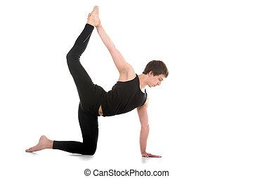 Variation of Chakravakasana Pose - Sporty young man working...