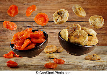 Variation of dried fruits: dried apricots and dried figs on...