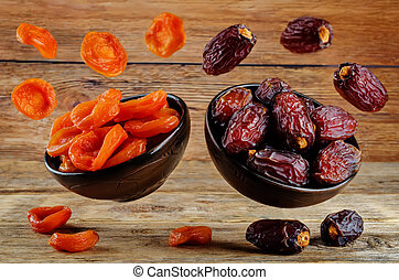 Variation of dried fruits: prunes and dried apricots on a...