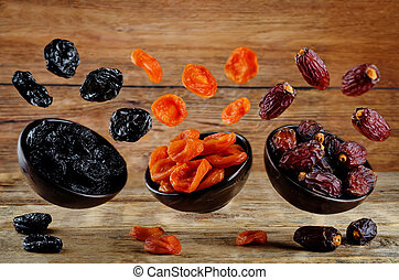 Variation of dried fruits: prunes, dried apricots, dates on...