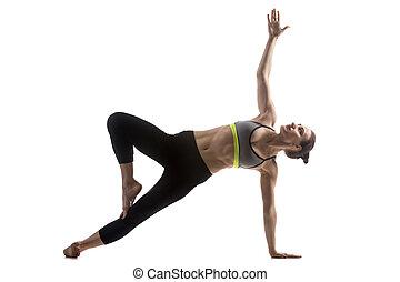 Variation of Side Plank Pose - Portrait of sporty fit...