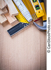 Variation of working building tools on wooden board vertical...