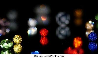 Varicoloured beads on black background