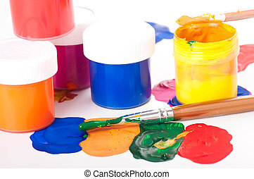 Varicoloured paints and brushes on a white background, ...