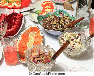 varied food-stuffs on white tablecloth