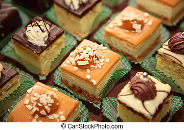 Varieties of cakes individual decorative desserts on the table at a luxury event, gourmet catering sweets